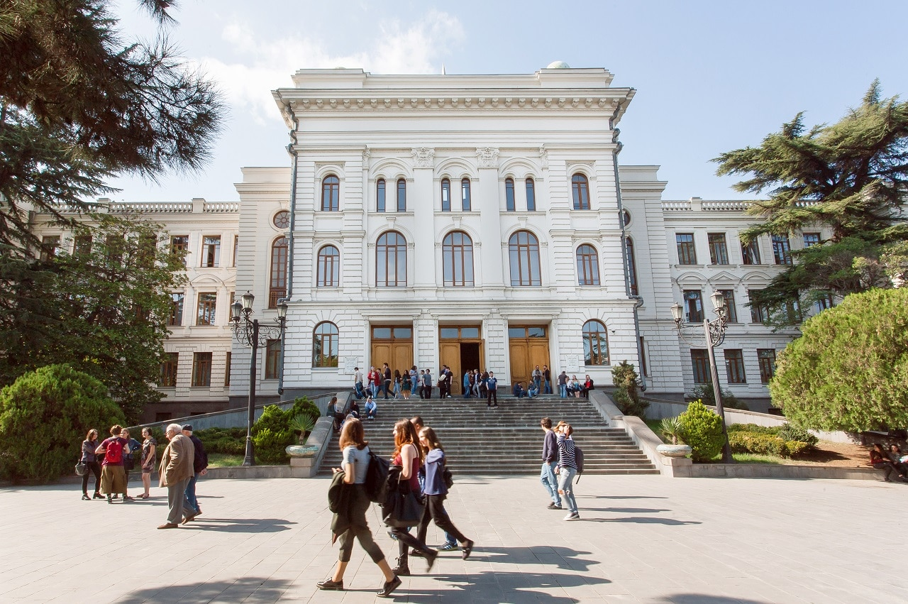 Students walking past main building of the Tbilisi State University, established 1918